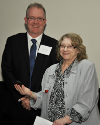 Loraine Luterbach accepting the award from Gord Johnston, ADM, Alberta Human Services