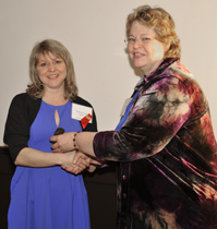 Roberta Kuzyk-Burton accepting the award from Linda McKay-Panos, President of the Alberta Association for Multicultural Education